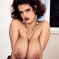 Redhead model Nilli Willis puts her big titties on show in alluring nylon socks