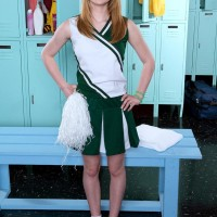 Ginger-haired teenager cheerleader Maci More uncovering super-cute youthfull girl juggs from white brassiere