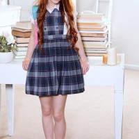 Ginger-haired teener Dolly Little baring petite juggs and tight bum from under college uniform