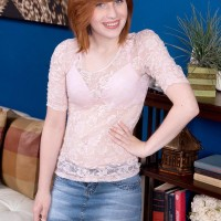 Ginger-haired nubile Sadie Kennedy sets her flat chest loose of her bra in first-timer action