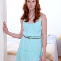 Red-haired teener solo female Linda Enticing modeling nude for tease picture shoot
