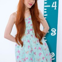 Redheaded teenager porno star Dolly Diminutive unveiling lil' funbags in super-cute bloomers