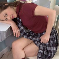 Coed Lucy Lady hikes up her micro-skirt to unsheathes cotton panties in her bedroom