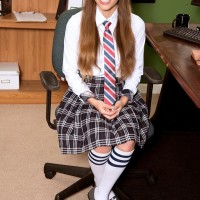College girl Skye reveals her puffy boobies and upskirt panties at her desk in long ponytails