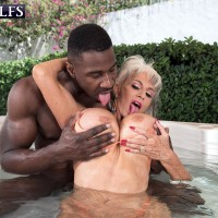 Sex grandmother Sally D'Angelo and her immense breasts take on a BIG EBONY PENIS outdoors in a Jacuzzi