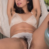 Sexy amateur Vivi Marie displays off her hairy armpits and total thicket out on the balcony