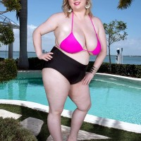Sexy BIG SEXY LADY Laddie Lynn bares her hefty all-natural boobs from a swimsuit top out by the pool