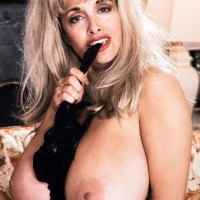 Fabulous golden-haired Alexis Enjoy whips out her monster-sized juggs from black lingerie