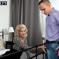 Marvelous yellow-haired granny Beata seduces a younger dude in a black mini-skirt and stockings