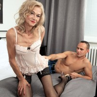 Spectacular platinum-blonde granny Beata entices a junior dude in a ebony miniskirt and stockings