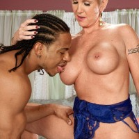 Jaw-dropping blond granny Honey Ray has her cunt fellated out by a younger ebony man