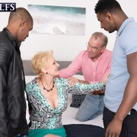 Marvelous yellow-haired grandmother Seka Black deepthroats on a couple of huge black cocks during MMF sex