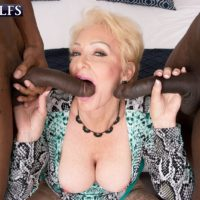 Alluring ash-blonde grandma Seka Ebony gargles on a duo of immense ebony hard-ons during MMF sex