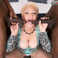 Alluring ash-blonde grandma Seka Ebony gargles on a duo of immense ebony hard-ons during MMF sex