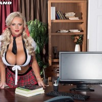 Seductive fair-haired schoolgirl Katie Thornton pinches her hard nips after uncovering her giant breasts