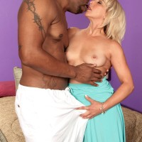 Irresistible grandma Andi Roxxx has her cunny fellated out by her youthfull black paramour