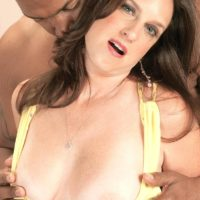 Enticing grandmother Gillian Sloan showcases her shaved beaver with help from black toy dude