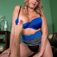 Alluring Latina MILF over 50 Marcella Guerra vaunting huge upskirt butt before baring knockers