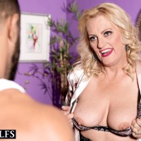 Enticing older light-haired Woman Dulbin tempts a younger guy in a provocative lingerie ensemble