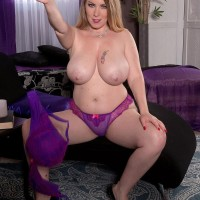 Cool MILF Desiree sets her monster-sized tits loose of a purple dress and bra in solo activity