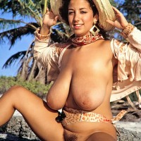 Foxy MILF Devon Daniels flashes her giant hooters while at the beach in boots