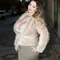Super-sexy MILF Micky Bells sets her big titties free off a tight fitting dress during solo activity
