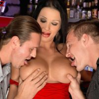 Magnificent MILF Patty Michova gives two boys blowjobs simultaneously in a bar