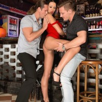 Alluring MILF Patty Michova gives 2 boys oral jobs simultaneously in a bar