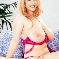 Marvelous MILF Ruth Tyler puts her massive knockers on show in see through stockings and high-heeled shoes