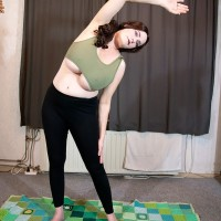 Jaw-dropping red-haired solo girl Cleo releases her giant breasts during a yoga routine