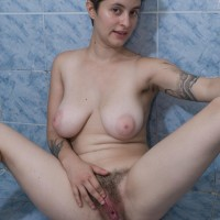 Short haired all-natural first-timer girl Sue showcasing fur covered underarms and cunny