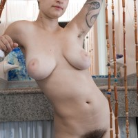 Short haired all natural amateur chick Sue flashing unshaven pits and coochie