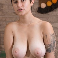 Short haired first timer girl Sue revealing enormous all natural boobies and unshaven cootchie