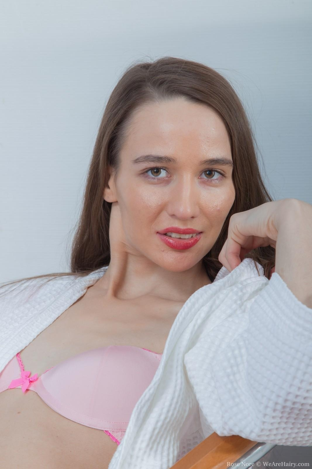 Skinny dark haired female Rose Nore exposing flat chest and wooly honeypot from lingerie