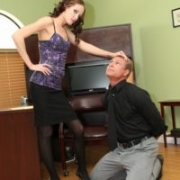 Slender mistress Haily Youthfull forces her sissy to his knees before fastening a chastity tool