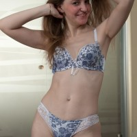 Petite breasted first-timer peeling off lingerie before uncovering furry coochie