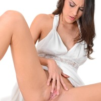 Solo female Carolina Abril peels off her milky dress and panties before fingering her fuckbox