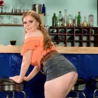 Stunner Jessica Taylor frees her humungous hooters at the bar with hair up in pigtails