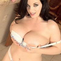 Solo female Joana Blessing sets her gigantic breasts loose of a boulder-holder in her panties
