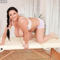 Stunner Juliana Simms wets down her monster-sized tits on a rubdown table in tight fitting shorts