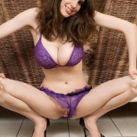 Stunner Lillian Faye pulls out her huge titties from her bra before taunting her hard nipples