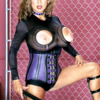 Solo female Minka showcases off her humungous boobies in a cupless onesie and a waist cincher