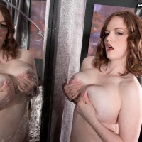 Solo female model Bebe Cooper revealing monster-sized hanging funbags from sweet lingerie in tights
