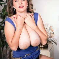 Solo chick Rhonda Baxter sets her enormous boobs and clean-shaved thicket free of dress in boots