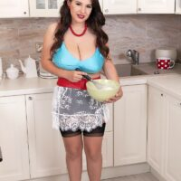 Solo girl Stacy Vandenberg sets her knockers free of a brassiere while baking in the kitchen