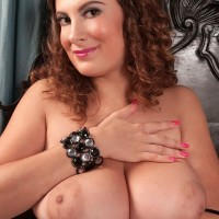 Babe Valory Irene unleashing huge MILF juggs from fishnet body-stocking in high-heeled shoes