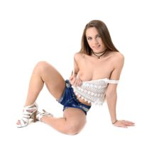 Solo chick Veronica Clark performs a striptease before finger her muff and anus