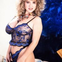 Solo chick with curly hair Tracy West sets her magnificent breasts loose of mind-blowing lingerie