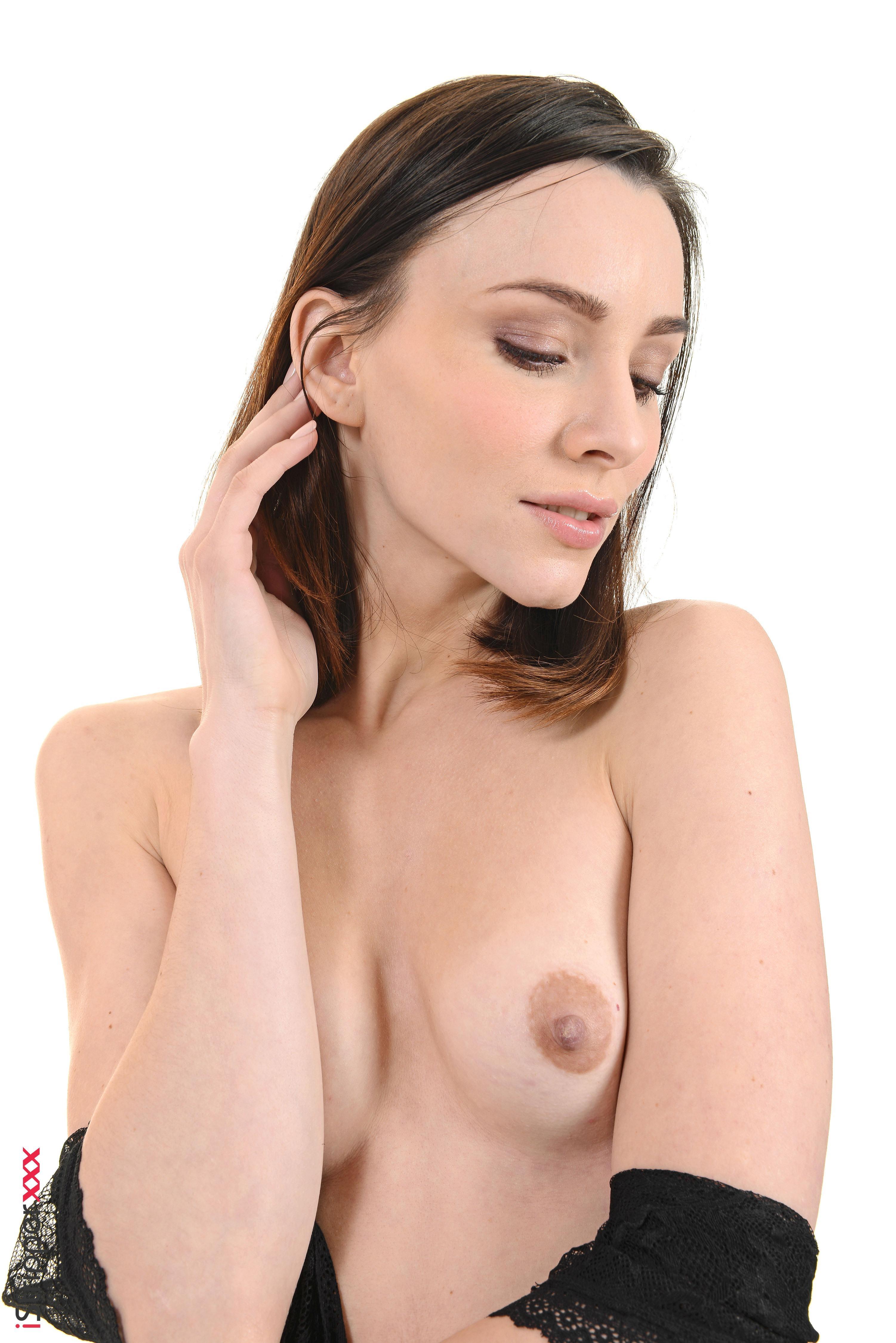 Solo model Adel Morel toys her bald muff after discarding black lingerie
