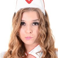 Solo model Alina N works herself loose from her naughty nurse unfiorm